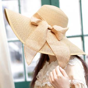 Bowknot Lace-Up Broad Brimmed Beach Straw Hat - Random Color - One Size