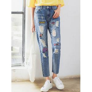 Patched Ripped Ankle Jeans