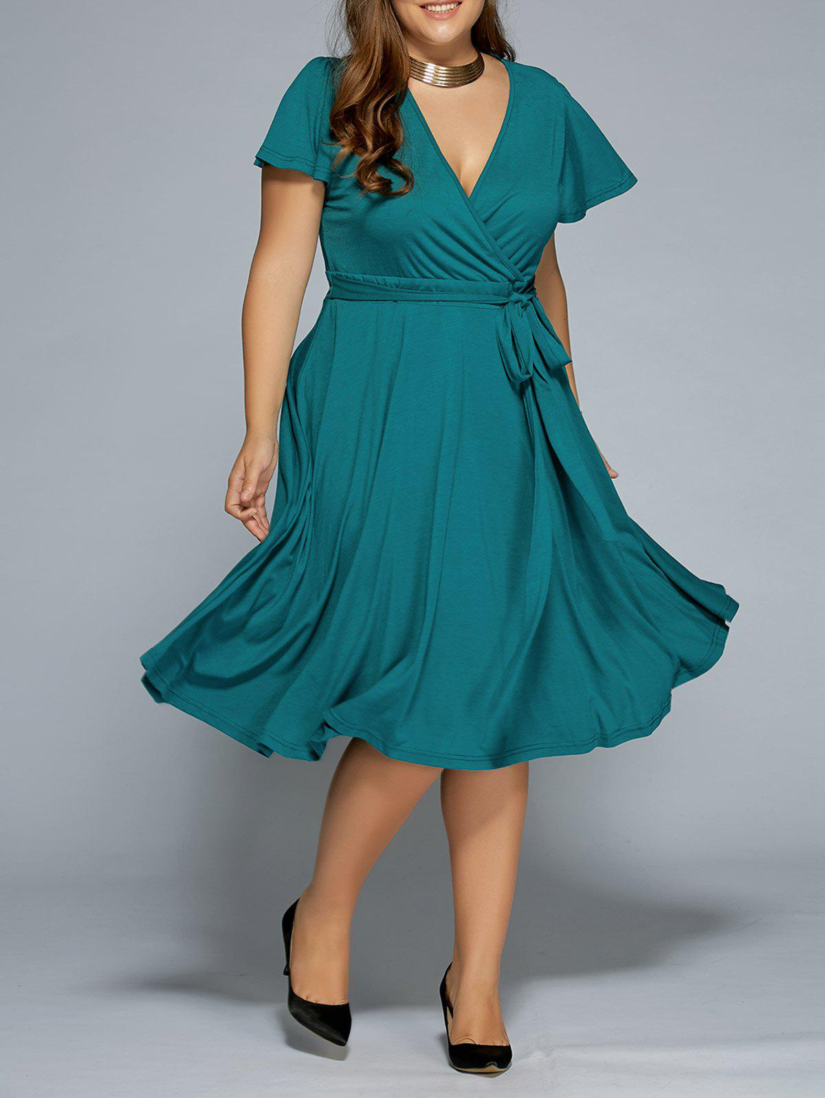Low Cut A Line Plus Size Surplice Front Tie Swing DressWOMEN<br><br>Size: 6XL; Color: GREEN; Style: Casual; Material: Cotton,Polyester; Silhouette: A-Line; Dresses Length: Mid-Calf; Neckline: V-Neck; Sleeve Length: Short Sleeves; Pattern Type: Solid; With Belt: No; Season: Summer; Weight: 0.5260kg; Package Contents: 1 x Dress;