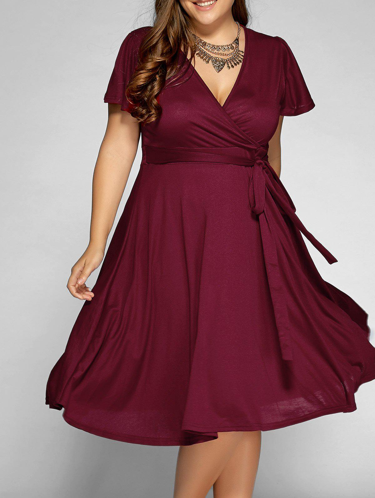 Low Cut A Line Plus Size Surplice Front Tie Swing DressWOMEN<br><br>Size: 3XL; Color: WINE RED; Style: Casual; Material: Cotton,Polyester; Silhouette: A-Line; Dresses Length: Mid-Calf; Neckline: V-Neck; Sleeve Length: Short Sleeves; Pattern Type: Solid; With Belt: No; Season: Summer; Weight: 0.5260kg; Package Contents: 1 x Dress;