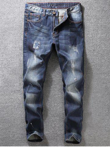 Trendy Tapered Fit Paint Splatter Scratched Patch Jeans