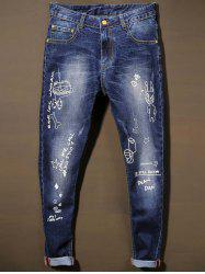Bleach Wash Cat' s Whisker Scrawl Jeans