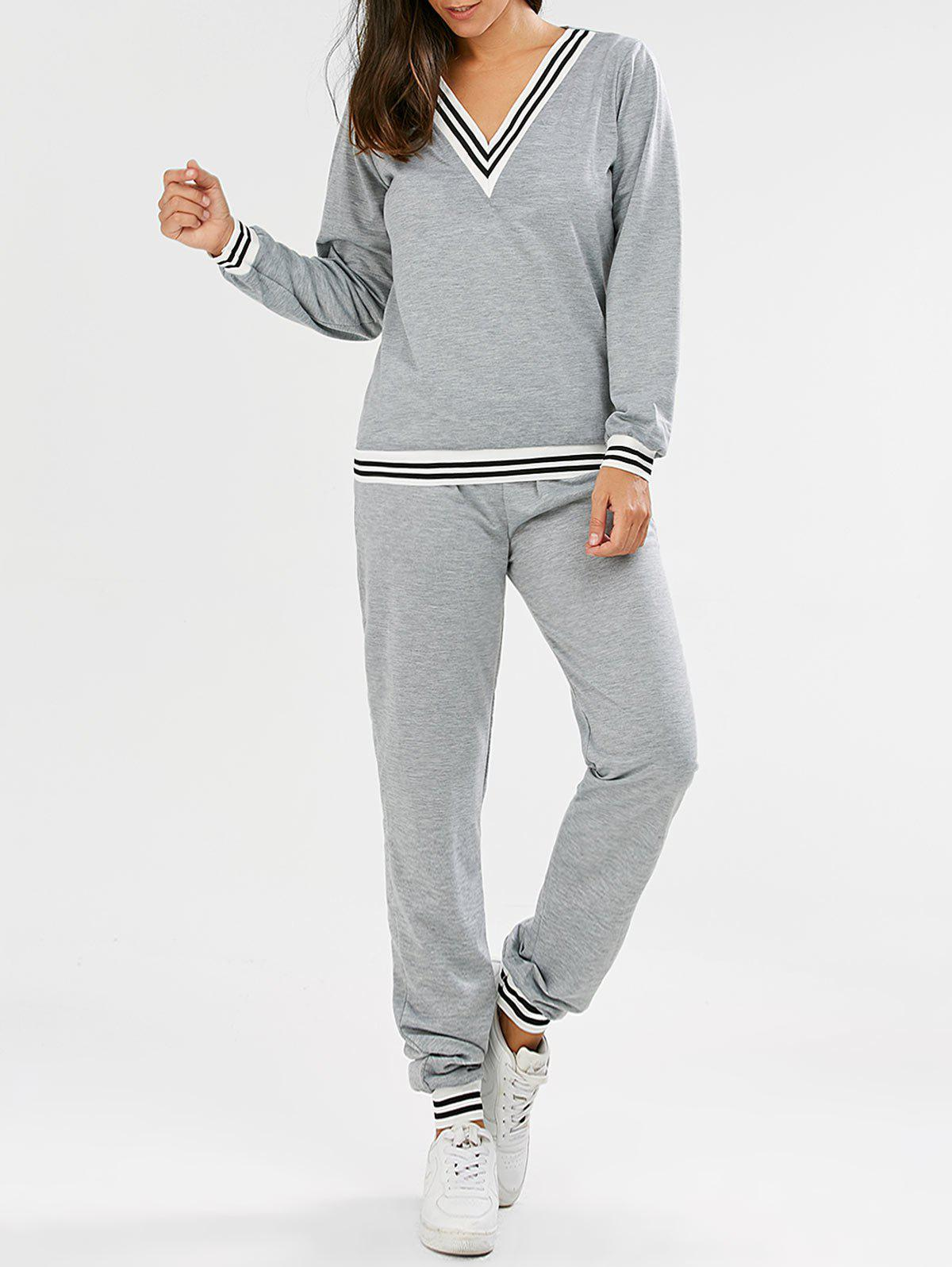 Fashionable V-Neck Long Sleeve Striped Sweatshirt + Fitted Pants Twinset For WomenWOMEN<br><br>Size: L; Color: GRAY; Style: Active; Length: Normal; Material: Polyester; Fit Type: Loose; Waist Type: Mid; Closure Type: Elastic Waist; Pattern Type: Striped; Pant Style: Pencil Pants; Weight: 0.4500kg; Package Contents: 1 x Sweatshirt 1 x Pants;