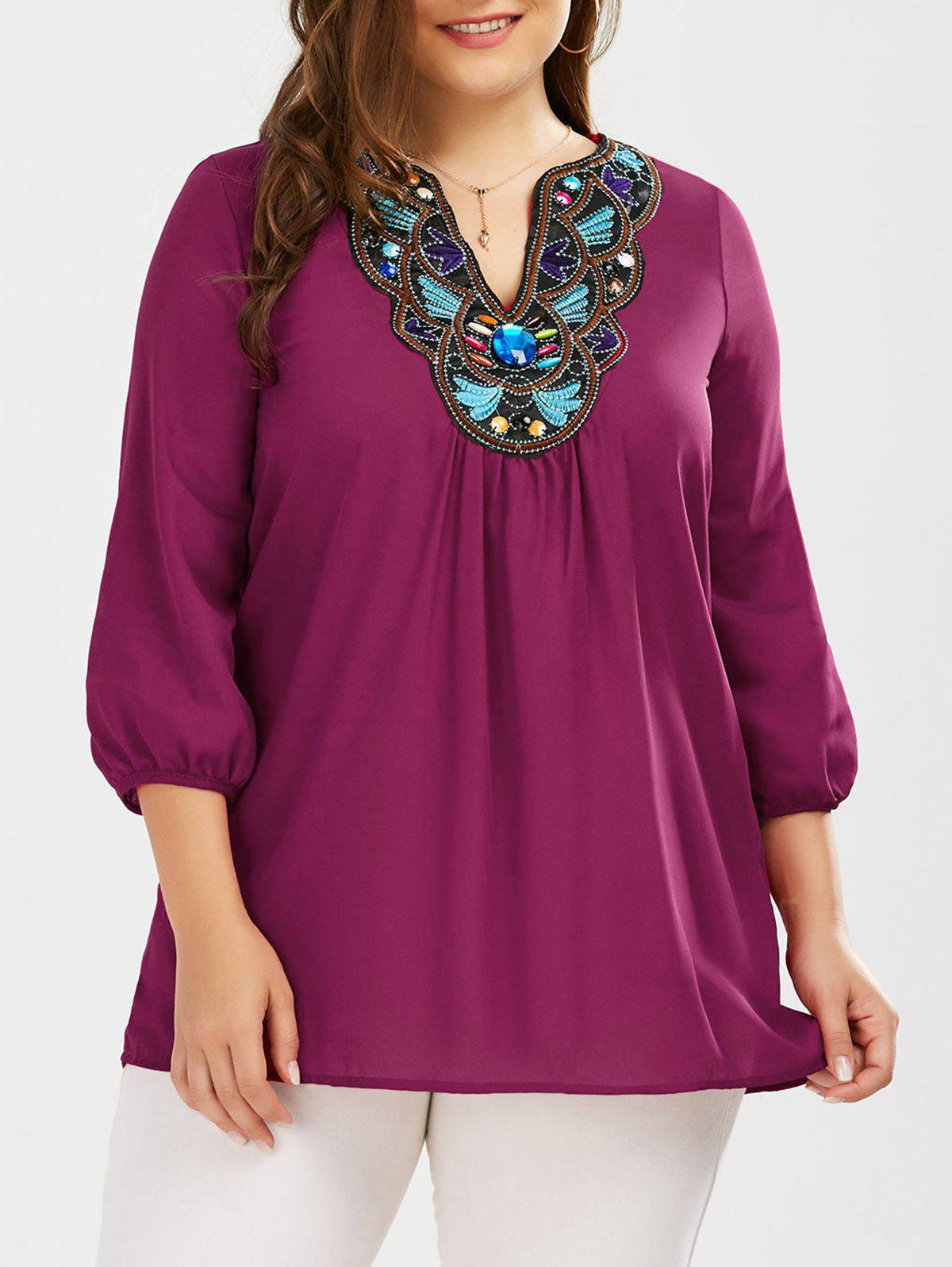 Plus Size Embroidered Rhinestone Tunic BlouseWOMEN<br><br>Size: XL; Color: PURPLISH RED; Material: Polyester; Shirt Length: Long; Sleeve Length: Three Quarter; Collar: V-Neck; Style: Casual; Season: Fall,Spring,Summer; Embellishment: Embroidery; Pattern Type: Others; Weight: 0.2370kg; Package Contents: 1 x Blouse;