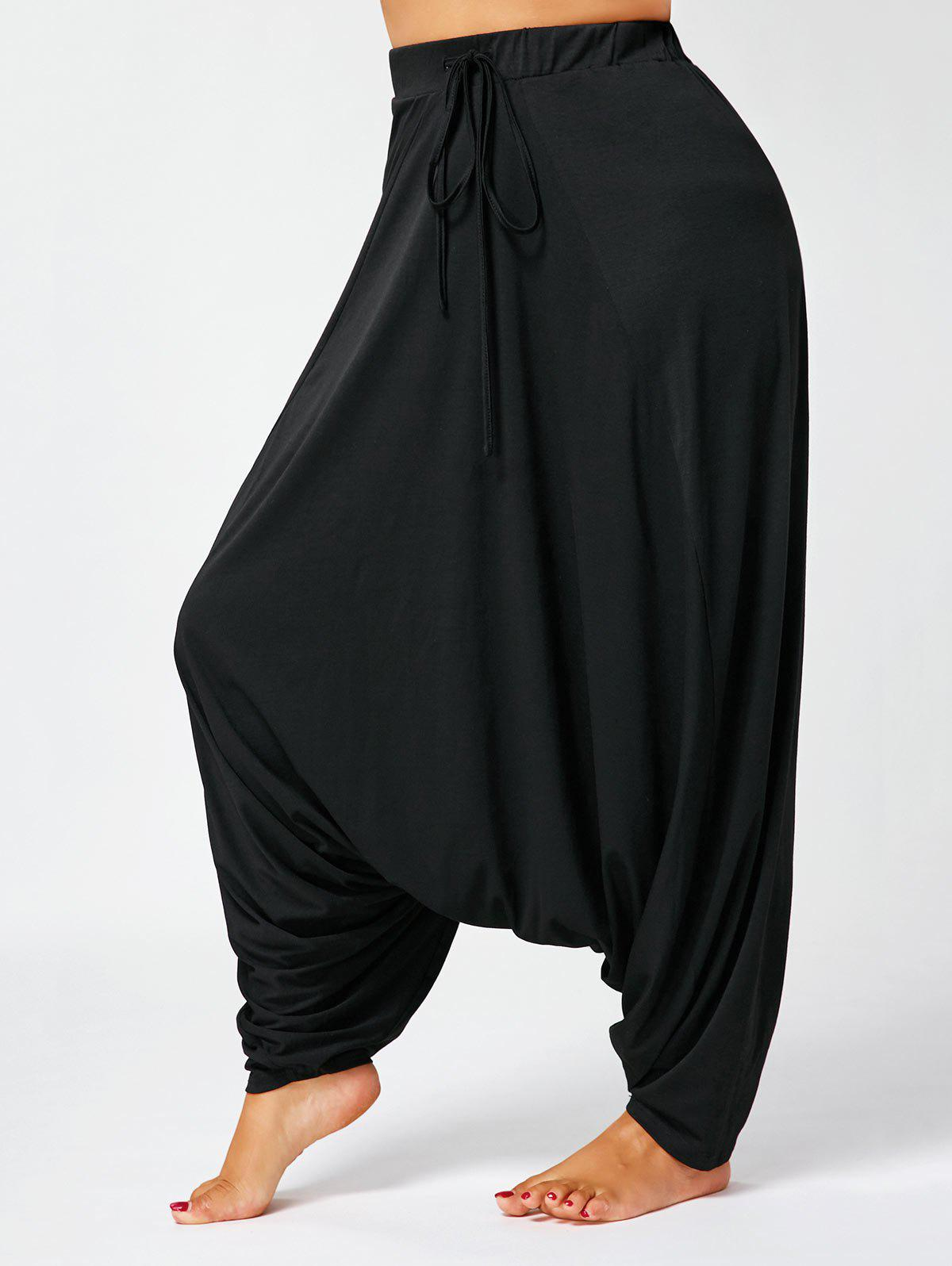 Drawstring Plus Size Drop Bottom Harem PantsWOMEN<br><br>Size: 4XL; Color: BLACK; Style: Casual; Length: Normal; Material: Polyester,Spandex; Fit Type: Loose; Waist Type: High; Closure Type: Drawstring; Front Style: Flat; Pattern Type: Solid; Pant Style: Harem Pants; Elasticity: Elastic; With Belt: No; Weight: 0.5000kg; Package Contents: 1 x Pants;