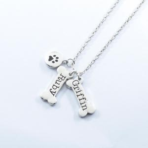 Engraved Ruby Griffin Pawprint Bone Charm Necklace
