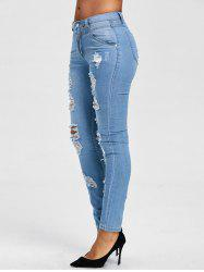 Light Wash Distressed Jeans -