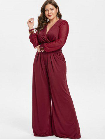 8e8dba23f12 Plus Size High Waisted Surplice Jumpsuit with Rivets
