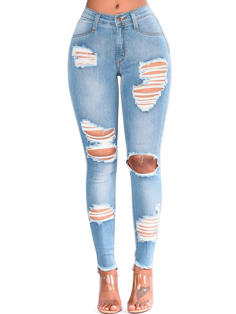 Shop Ripped Cut Out Frayed Skinny Jeans