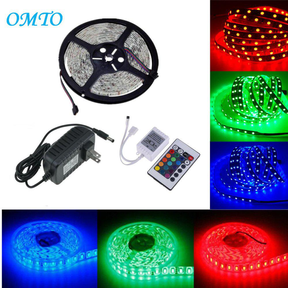 OMTO DC12V 5M / 16.4 FT SMD3528 Non-Waterproof LED Light Strip Power Supply RGB Color Changing Kit with 24 Key IR Controller for Kitchen Bedroom Sitting Room CarHOME<br><br>Color: RGB; Brand: OMTO; Type: Flexible LED Light Strips,LED Strip Light,RGB Strip Lights; Light Source Color: RGB; Length ( m ): 5; Wattage (W): 24; Voltage: 100 - 240V,DC12V; Power Supply: 12V; Features: Color-changing,Cuttable,Festival Lighting,Linkable,with Remote Control; Light Source: 3528 SMD,LED; Beam Angle: 180; LED Quantity: 300; Color Temperature or Wavelength: RGB;