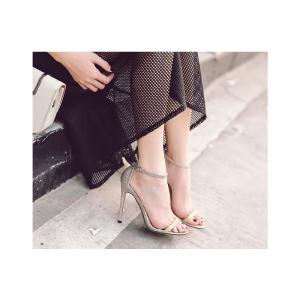 The Rubber Sole of The Lady Has A High Heel and Sandals -