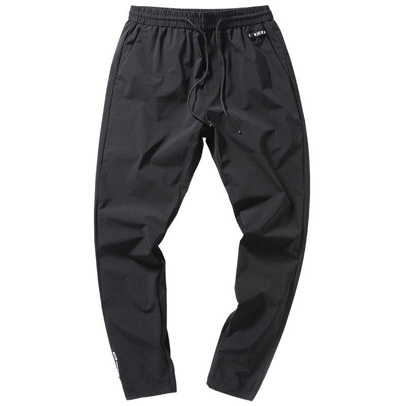 Latest Men's Ribbons Decorated Feet Nine Points Sports Casual Pants