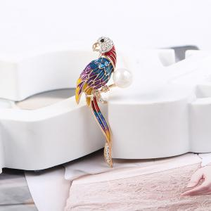 Fashionable Dress Is Decorated with A Blue Parrot Brooch -