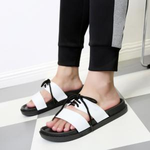 The New Lady Buckled The Leather Slippers -