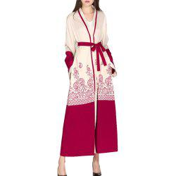 A Long Sleeved Coat with A Red Belt -