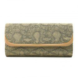 A party and dinner bag with a snake-print lid -
