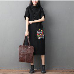 A High-Necked Knit Embroidered Dress -